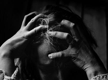 woman scratching hair hand