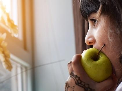 woman eating apple food