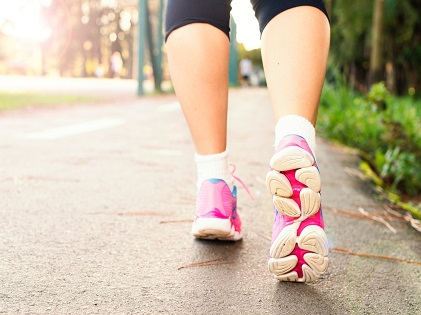 photo-of-woman-wearing-pink-sports-shoes-walking