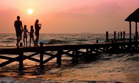 man-beach-holiday-woman-family